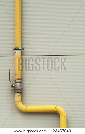 Yellow Gas Pipe With A Crane And Valve