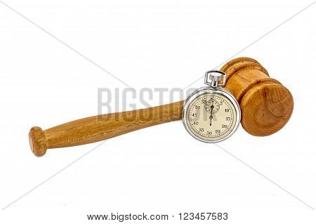 Old silver stopwatch and auction wooden gavel on the white background
