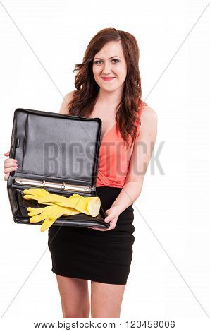 funny picture of young business woman trying to close her briefcase after she put in it yellow rubber gloves