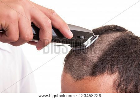 Man Having A Haircut With A Hair Clippers Over A White Background