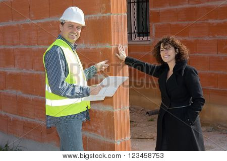Meeting on a construction site with customer and architect