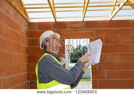 Portrait Of Confident Bricklayer At Construction Site