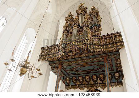 GDANSK POLAND - JULY 6 2009: Merten Friese organ case from 1629 rebuilt with new Hillebrand instrument at St. Mary's Basilica