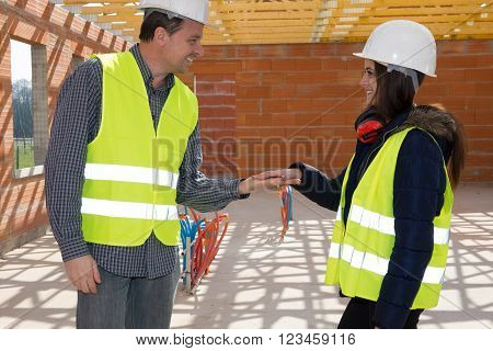 Construction Engineers Holding Hands To Be Agree