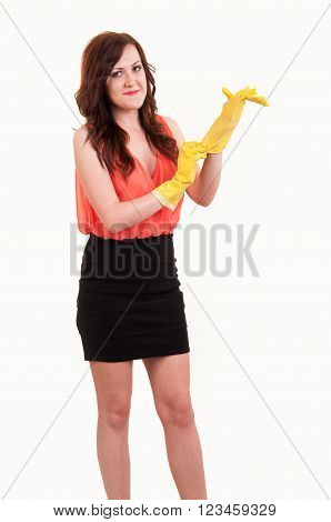 funny picture of young business woman puting on hands yellow rubber glove over white background