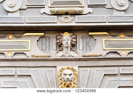 Closeup of a face on the Great Arsenal or Great Armoury in Gdansk