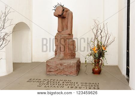 GDANSK POLAND - JULY 6 2009: Memorial for the 2779 priests killed in World War II. A sculpture of Jesus Christ weeping in St. Mary's Basilica