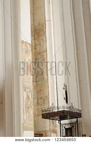 GDANSK POLAND - JULY 6 2009: Murals or hagiography on a wall inside St. Mary's Basilica