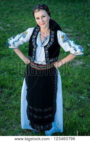 Full Length Portrait Of Young Beautiful Singer Posing In Traditional Costume, Romanian Folklore