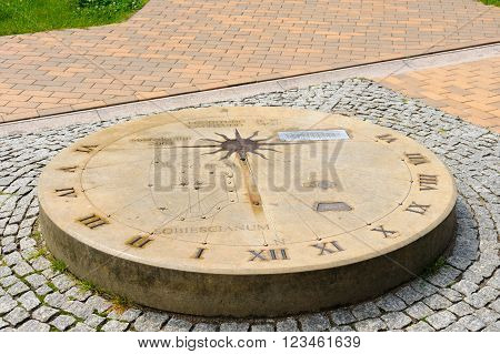 Sundial on the ground with Jan Heweliusz's Scutum constellation of stars arranged on a shield with a cross relative to Sobieski's coat of arms