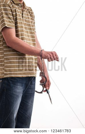 Close up of a man handcuffed with a knife in hand