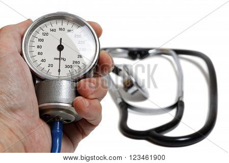 Hand with medic instrument for measuring blood pressure - Professional Blood Pressure Kit with Pressure Cuff isolated on white with shadow. Shallow focus.
