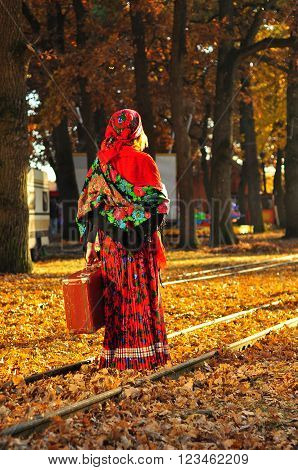 Romantic Young Gypsy Woman Leave With The Suitcase In Hand On Railway Road, In Autumn