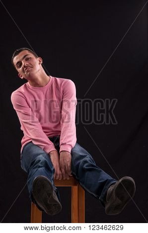 Young Man Who Is Foolishly, Seated On The Chair