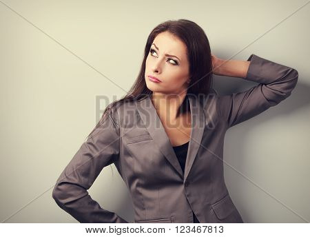 Annoyed Concentration Business Woman In Suit Looking Up? Toned Portrait