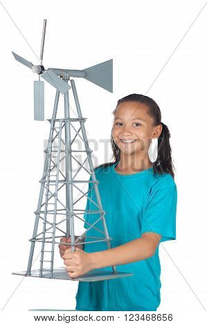 A smiling girl sports a model windmill she just completed.