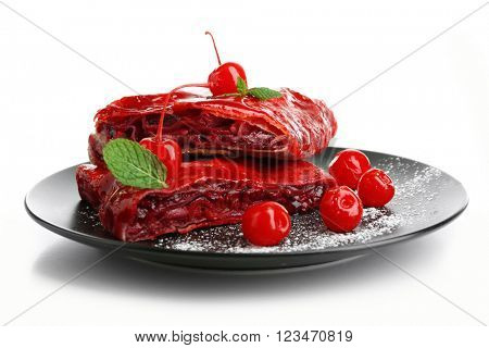 Cherry strudel with mint on plate, isolated on white
