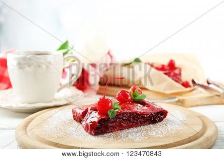Cherry strudel with mint and cup of tea