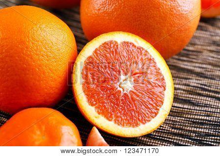 Piece of orange on cloth background