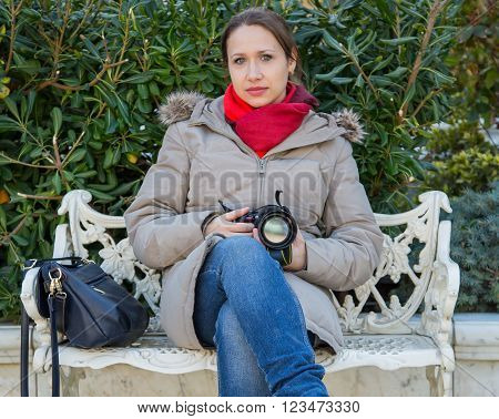 woman photographer with camera, and red scarf