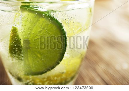 Mojito drink with lime, closeup