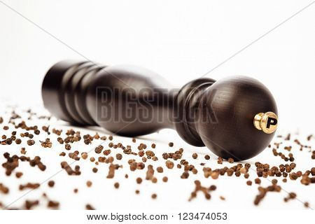 pepper mill and peppercorns, isolated on white