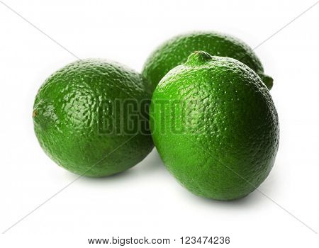 Few limes, isolated on white