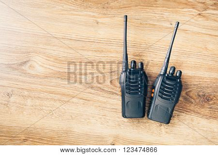 portable radios Walkie-talkie on wooden background