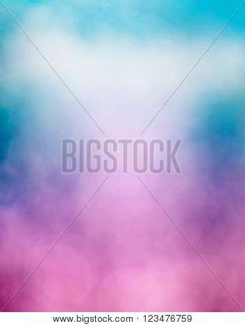 An abstraction of clouds and fog with a purple to blue gradient and subtle bokeh light effects. Image is soft focus.