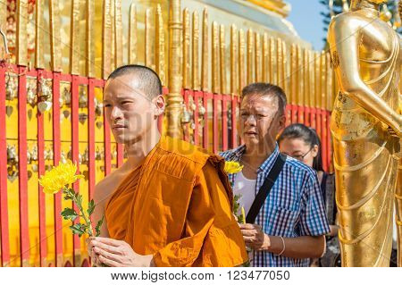 CHIANG MAI, THAILAND - FEBRUARY 5: Thai people worship at Wat Phra That Doi Suthep on February 5, 2016 in Chiang Mai. This Buddhist temple founded in 1383 is the most famous in Chiang Mai.