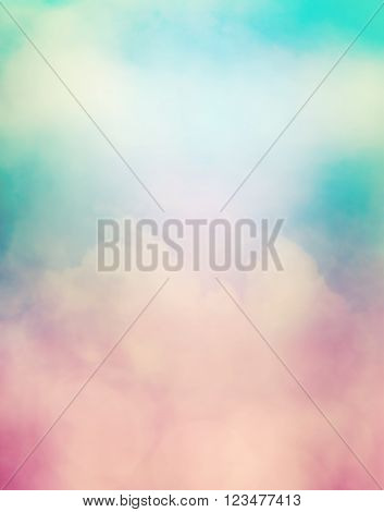 A soft focus abstraction of clouds fog and subtle bokeh light effects. Image displays a soft retro look.