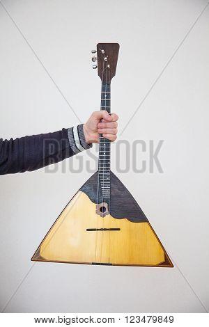 The balalaika Russian folk musical instrument yellow
