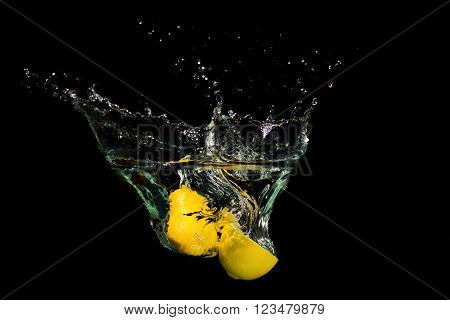Lemon In Water On Black Background