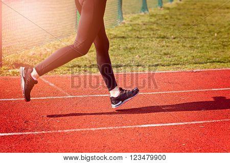 Woman Running Around The Track