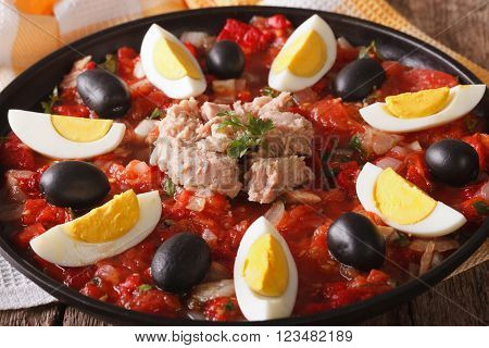Arabic Cuisine: Tuna Salad With Vegetables And Eggs Close-up. Horizontal