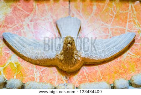 BETHLEHEM PALESTINE - FEBRUARY 18 2016: The small dove over the entrance to the Milk Grotto on February 18 in Bethlehem.