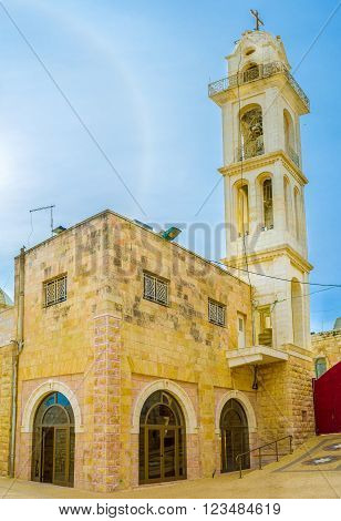 BETHLEHEM, PALESTINE - FEBRUARY 18, 2016: The mystical light sky effect over the St. Mary's Syrian Orthodox Church, on February 18 in Bethlehem.