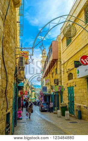 BETHLEHEM, PALESTINE - FEBRUARY 18, 2016: The Pope Paul IV is the main pedestrian street that connects Manger Square with local market on February 18 in Bethlehem.