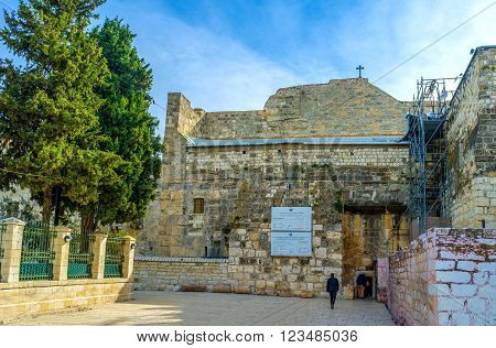 BETHLEHEM, PALESTINE - FEBRUARY 18, 2016: The main historical entrance to the Church of the Nativity from the Nativity Square on February 18 in Bethlehem.