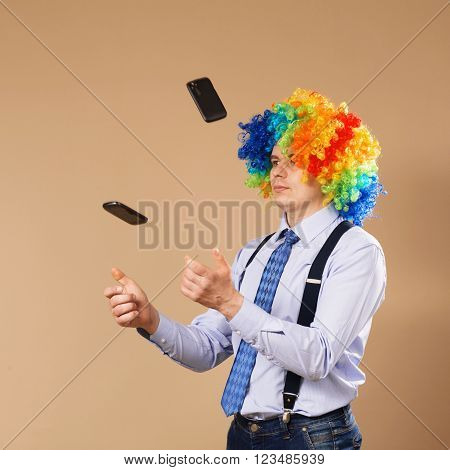 Businessman Juggling Mobile Phones