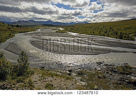Sun and Clouds on the braided Savage River in Denali National Park in Alaska