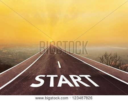 Text start on long paveway road aboved blurred top city view along to golden sun rise for abstract background with copy space