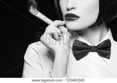 Gangster woman with cigar closeup black and white