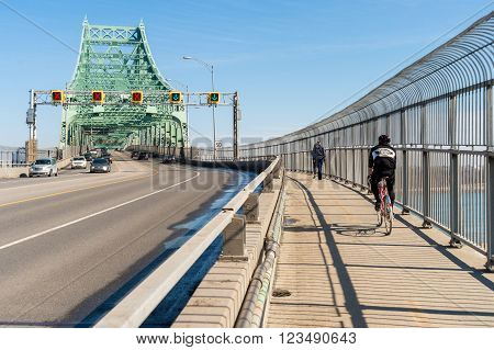 MONTREAL, CA - March 27th 2016. Traffic on Jacques Cartier bridge crossing Saint Lawrence river.