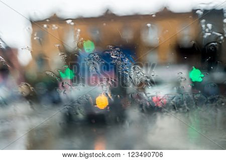 Traffic Through A Car Windscreen During Heavy Rain.