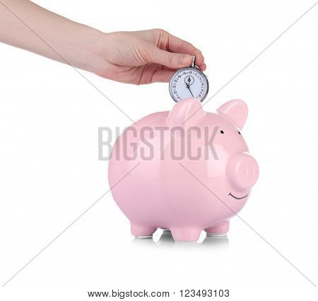 Pink piggy bank and a hand holding timer above it isolated on white
