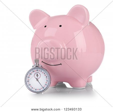 Pink piggy bank and a timer  isolated on white