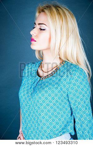 High fashion look. Portrait of a fashionable model, perfect skin. Close up. Studio shot. High key