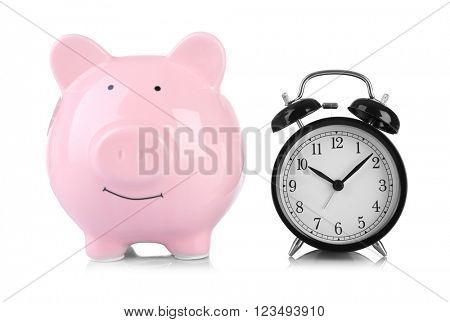 Pink piggy bank and clock isolated on white