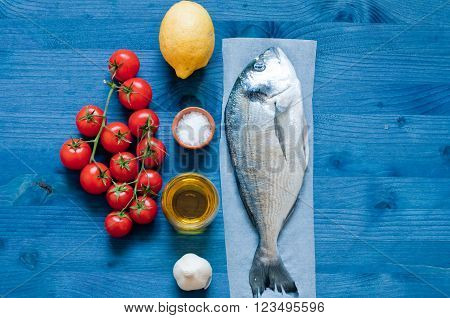 Fish bream cooked in crazy water typical recipe of southern Italy with sea water tomatoes onions and garlicitaly